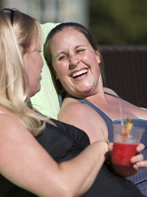 Lisa Cope and Jen Lewis, from Ohio, soak up the sun at the Hyatt Regency Scottsdale Resort and Spa at Gainey Ranch in December 2010.