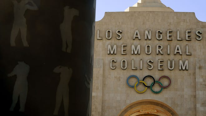 An Olympic themed monument stands beside the Los Angeles Memorial Coliseum on Feb. 22.