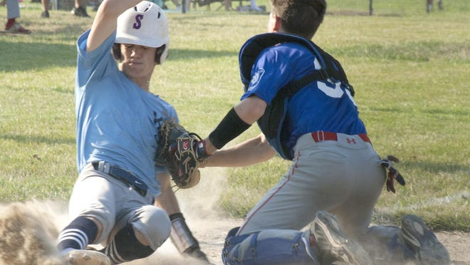 Ottawa Arrows catcher Liam Robertson tags out a Topeka runner attempting to score a run Monday at Harvey M. Drake Field. Ottawa split the doubleheader. [PHOTO BY GREG MAST/THE OTTAWA HERALD].