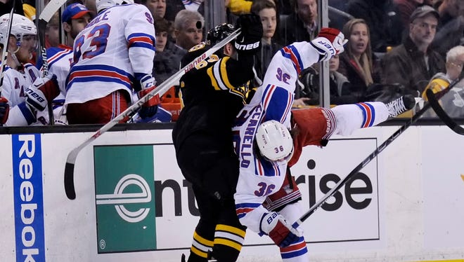Boston Bruins left wing Brad Marchand (63) collides into New York Rangers right wing Mats Zuccarello (36) during the third period at TD Banknorth Garden.