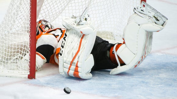 Flyers' Brian Elliott (37) slides head first into the goal as Anaheim scores Tuesday, Oct. 24, 2017 in Philadelphia.