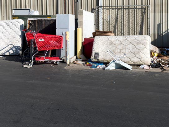 Trash has collected behind the building that was once