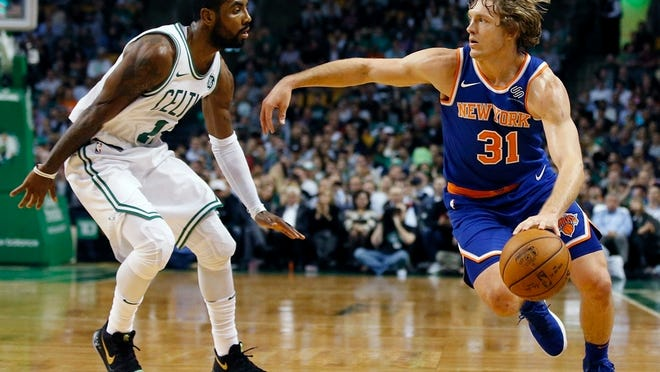 New York Knicks' Ron Baker (31) drives past Boston Celtics' Kyrie Irving (11) during the first quarter of an NBA basketball game in Boston, Tuesday, Oct. 24, 2017. (AP Photo/Michael Dwyer)
