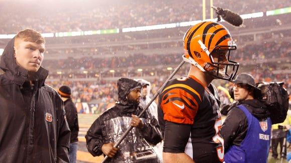 Bengals quarterbacks Andy Dalton (left) and AJ McCarron