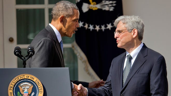 Federal appeals court judge Merrick Garland (right) shakes hands with President Barack Obama on Wednesday, March 3, 2016 at the White House after Obama nominated Garland to fill a vacancy on the Supreme Court.