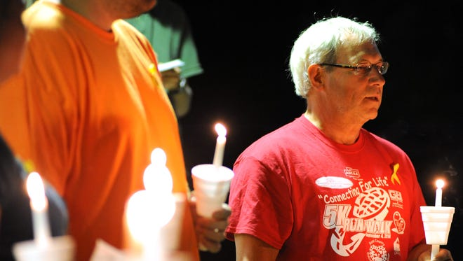 Jim Butt, with the Ross County Suicide Prevention Coalition, addresses the crowd gathered during a 2014 vigil for Suicide Awareness on the campus of Ohio University-Chillicothe.