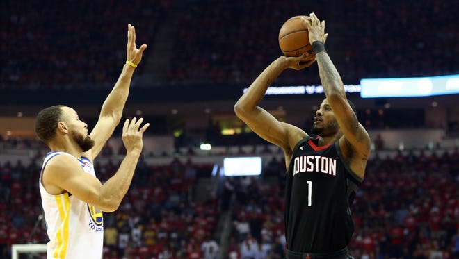 May 24, 2018; Houston, TX, USA; Golden State Warriors guard Stephen Curry (30) defends the shot of Houston Rockets forward Trevor Ariza (1) during the first quarter in game five of the Western conference finals of the 2018 NBA Playoffs at Toyota Center.