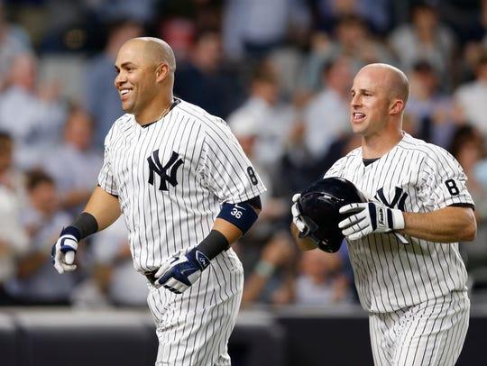 New York Yankees Carlos Beltran and Brett Gardner head