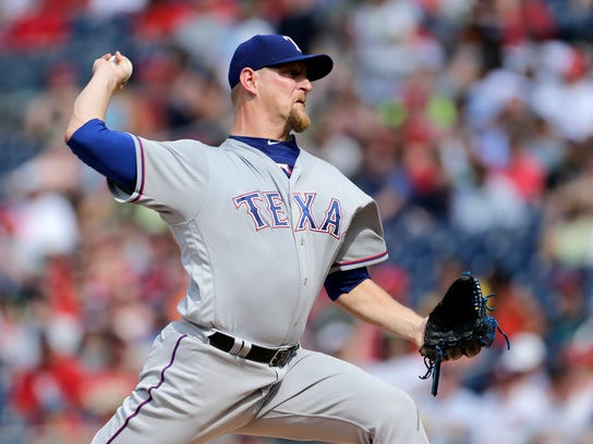 Texas Rangers starting pitcher Austin Bibens-Dirkx throws during the first inning of a baseball game against the Washington Nationals, Sunday, June 11, 2017, in Washington. (AP Photo/Mark Tenally)