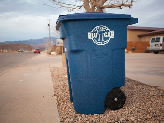 Blu Can recycling bins placed on a curb in Washington City Wednesday, Feb. 17, 2016.
