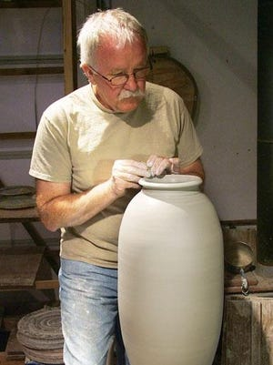 Tony Staroska throws clay on the potter's wheel to create a vessel at Juddville Clay Studio Gallery, one of the sites for the Oct. 1 Artist Demo Day.