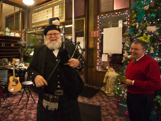 A musician enjoys the crowd at the 12th Annual Olde
