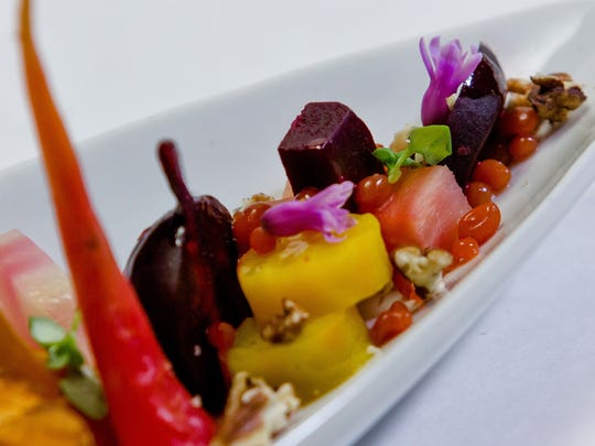 Menu items at dish Creative Cuisine include this beet salad.
