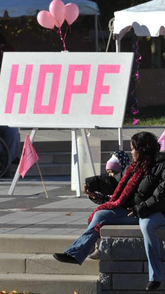 While the walkers were gone, a few stayed behind and kept hope alive at the Making Strides against breast cancer 5k walk in Pack Square on Sat.