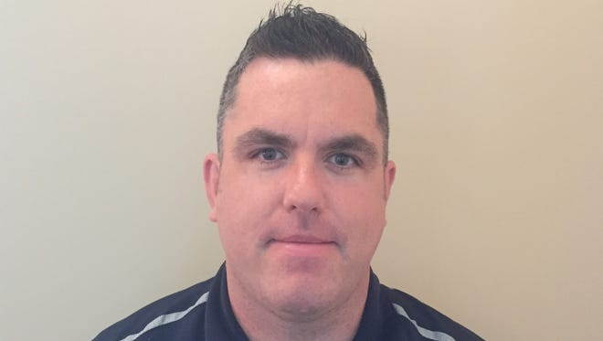 Justin Clark is the new hockey coach at Pope John Paul II.