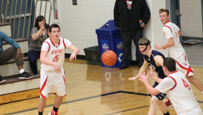 Bethel-Tate's Caleb Bastin feeds the ball to teammate Jake Stolz in the post.
