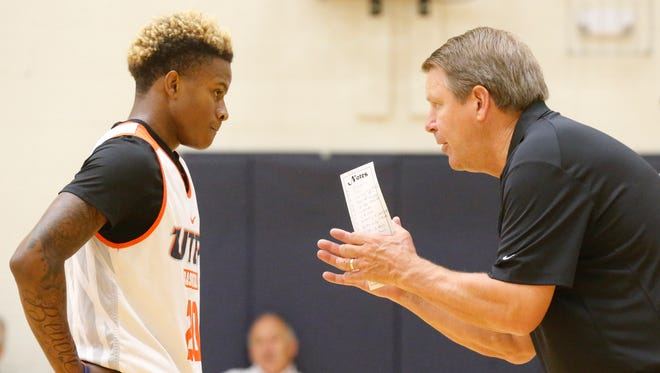 UTEP head coach Tim Floyd has a word with incoming freshman guard Joey St. Pierre during practice in August.