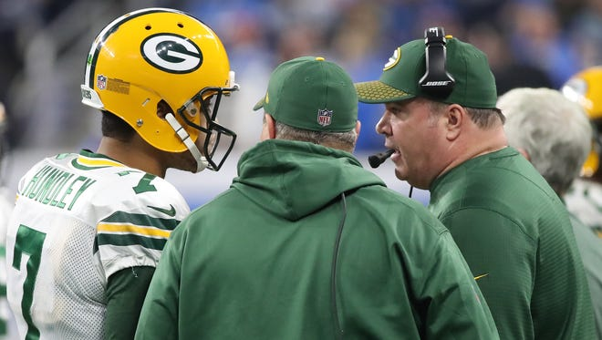Green Bay Packers quarterback Brett Hundley (7) confers with head coach Mike McCarthy during the game against the Detroit Lions on Dec. 31, 2017 at Ford Field in Detroit.