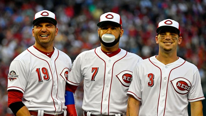 National League infielder Joey Votto of the Cincinnati Reds (19), National League infielder Eugenio Suarez of the Cincinnati Reds (7) and National League infielder Scooter Gannett of the Cincinnati Reds (3) before the 2018 MLB All Star Game at Nationals Ballpark.
