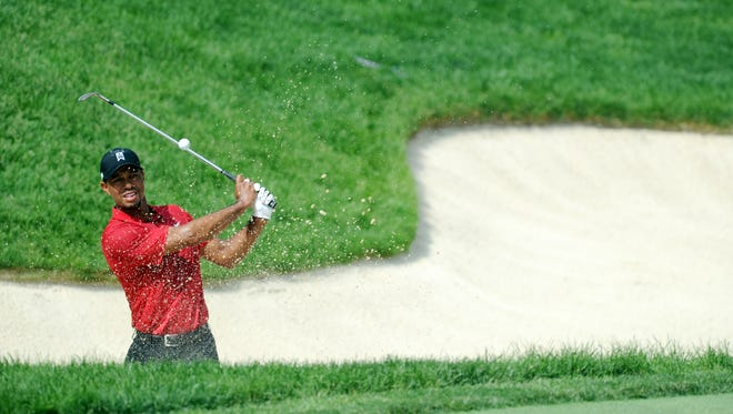 Tiger Woods takes a shot from a 17th bunker during the final round of the Memorial Tournament at Muirfield Village Golf Club on June 7, 2015.