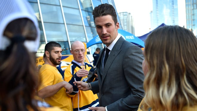 Defenseman Roman Josi greets fans during the Predators' Gold Walk on Lower Broadway on Tuesday, Oct. 10, 2017.
