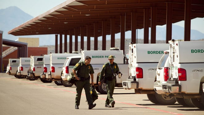 U.S. Border Patrol agents walk toward their truck at the Brian A. Terry Border Patrol Station in Bisbee, Ariz., in this 2012 photo. Attorney General Eric Holder said June 18, 2014, that the United States has extradited from Mexico one of five suspects wanted in connection with Terry's 2010 killing.