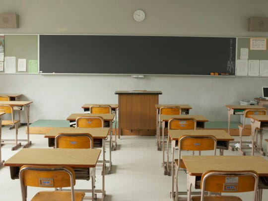 Stock image of an empty classroom.