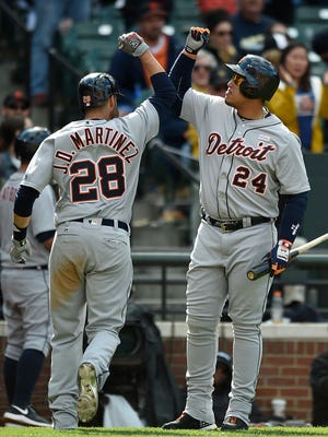 Detroit Tigers' J.D. Martinez, left, and Miguel Cabrera celebrate Martinez's solo home run against the Baltimore Orioles in the eighth inning of a baseball game, Sunday, May 15, 2016, in Baltimore. The Tigers won 6-5.