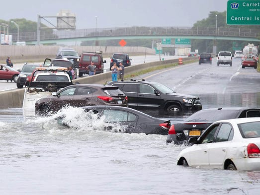 Cars stuck in flood waters on Sunrise Highway at Carlton Avenue during torrential rainfall in Islip Terrace, N.Y. The National Weather Service reported that Islip received 13 inches of rain for the day, essentially doubling the all-time record for rainfall in a single day for the town.