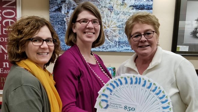 Sherry Gurno, of Fond du Lac, is the winner of $500 in downtown gift certificates in the fourth annual Downtown Fond du Lac Shop Small raffle. Pictured are, from left: Julie Balson, owner of Gallery and Frame Shop; Dusty Krikau, from the Downtown Fond du Lac Partnership; and winner Sherry Gurno.