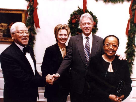 James Cameron (left), Hillary Clinton, President Bill Clinton & Virginia Cameron during the Camerons' visit to the White House in December of 1999. James Cameron, the founder of America's Black Holocaust Museum in Milwaukee, was the only known survivor of a lynching.