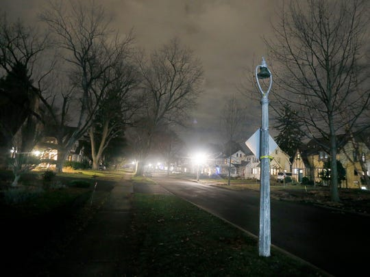 Near the intersection of Oakdale and Warrington drives in Brighton's Bel-Air neighborhood where the historic harp lamps are frequently out of service. A long exposure for this image provides visibility to an otherwise dark area in which four to five lamps are out of service.