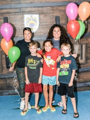 Director of Education/Ops Olivia Labrador and Marketing Coordinator Amy Storck with Caden Olivieri, Victoria Martin and Kaden Smith at the Children's Museum of the Treasure Coast's birthday celebration.