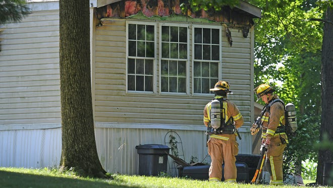 Firefighters battled a fire at 7788 Steam Corners road on Friday. The address was an unoccupied mobile home across from the entrance at the Mid-Ohio Sports Car Course.