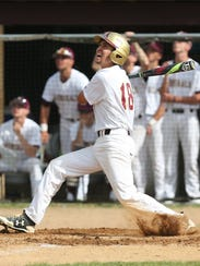 Arlington's Austin Zakow takes a swing during the Section