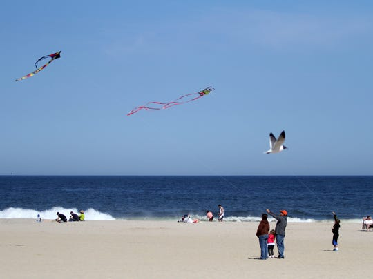 People fly kites in Point Pleasant Beach.