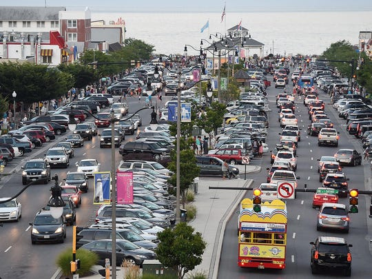 Cars jam up Rehoboth Avenue looking eastbound towards the boardwalk on a Saturday evening in downtown Rehoboth Beach.