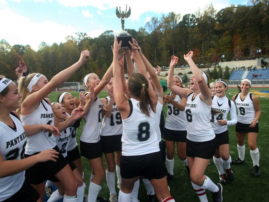 Bridgewater-Raritan celebrates their 2-1 overtime victory over Bernards in the Somerset County field hockey championship game, Sunday, October 26, 2014, at Mount Saint Mary Academy in Watchung, NJ. Jason Towlen/STAFF PHOTO