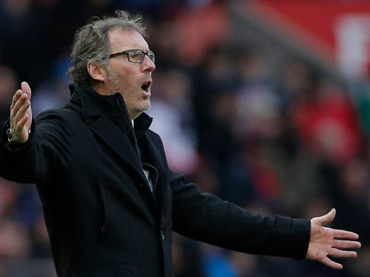 Paris St. Germain coach Laurent Blanc reacts during the French league one soccer match between PSG and Caen, in Paris, France, Saturday, Feb. 14, 2015. (AP Photo/Christophe Ena)