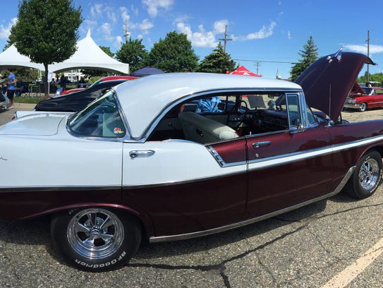 A 1956 Chevrolet Bel Air fills a parking space at the