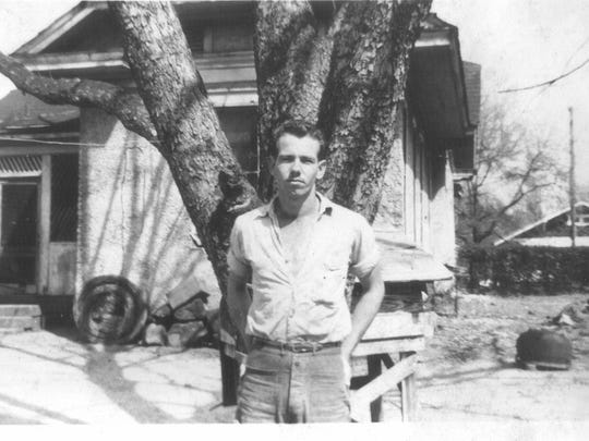 Robert Osbourne on leave from military service in 1946 stand behind 109 North Lewis St.