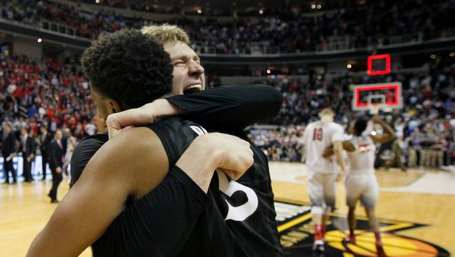 Xavier Musketeers guard Trevon Bluiett (5) and guard J.P. Macura (55) hug as they celebrate after the game.