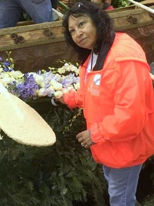 Esther Mancillas Davis works on the Donate Life Float for the 2017 Rose Parade in Pasadena, California.