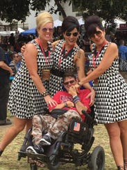 The Vonettes pose with fan Zachary Coleman, who will