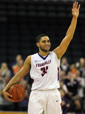 University of Evansville's D.J. Balentine waves to the crowd after being presented the game ball for becoming Evansville's all-time leading during a game against Missouri State on Feb. 6, 2016, at the Ford Center.