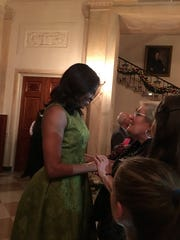 First lady Michelle Obama greets Grieco at the White