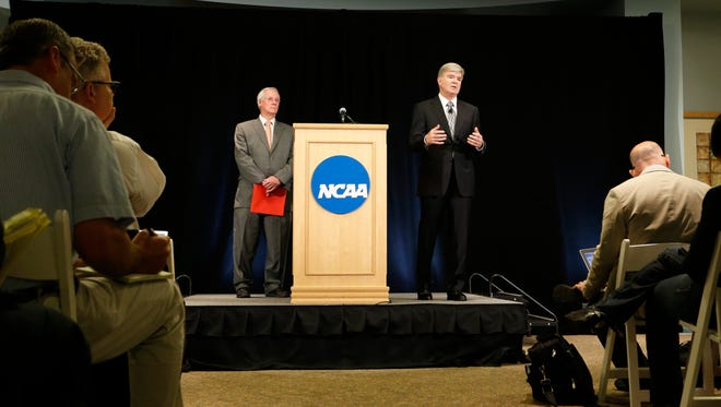 NCAA President Mark Emmert, left, and Ed Ray, chairman of the NCAA's executive committee and Oregon State president, address reporters after announcing penalties for Penn State in July 2012.