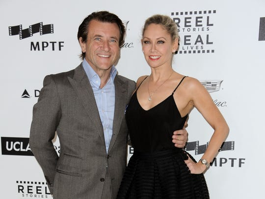 """Robert Herjavec, left, and Kym Johnson, partners on """"Dancing with the Stars,"""" were voted off on May 5. In this photo they are seen arriving at the 4th Annual Reel Stories, Real Lives Benefit held at Milk Studios on Saturday, April 25, 2015, in Los Angeles"""