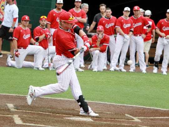"UL's Caleb Adams competes in the home run derby during UL's 2014 baseball fan day at M.L. ""Tigue"" Moore Field."