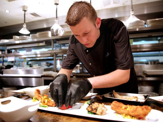 Sea Salt corporate chef Jason Goddard, shown preparing